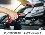 close up of hand charging car... | Shutterstock . vector #1195081315