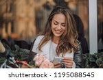 Happy Young Woman Reading A...