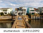luxury beach houses on the... | Shutterstock . vector #1195112092