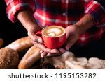 barista's hands are delivering... | Shutterstock . vector #1195153282