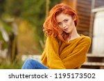 outdoors portrait of beautiful... | Shutterstock . vector #1195173502