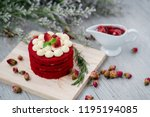 The Red Velvet Cake is placed on a wooden floor. It is suitable for parties in festivals of happiness such as Valentine