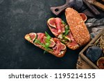 bruschetta with prosciutto ... | Shutterstock . vector #1195214155