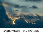 Small photo of Edges of shadowy cumulus clouds illuminated by setting sun, for themes of weather, change, transition