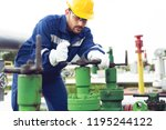 worker closes the valve on the...   Shutterstock . vector #1195244122