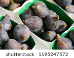 violet figs in a paper... | Shutterstock . vector #1195247572