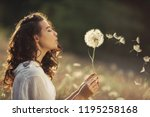 beautiful young woman sitting... | Shutterstock . vector #1195258168