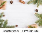 gifts and fir branches form a... | Shutterstock . vector #1195304332