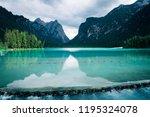 dobbiaco lake in the dolomites... | Shutterstock . vector #1195324078