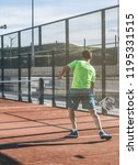 man playing padel in a orange... | Shutterstock . vector #1195331515
