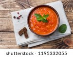tomato soup in a wooden bowl... | Shutterstock . vector #1195332055