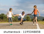 father and children playing on... | Shutterstock . vector #1195348858