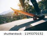 skateboarder skateboarding at... | Shutterstock . vector #1195370152