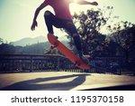 skateboarder skateboarding at... | Shutterstock . vector #1195370158