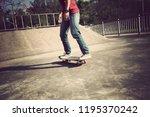 skateboarder skateboarding at... | Shutterstock . vector #1195370242