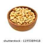 cashew nuts in wooden bowl on... | Shutterstock . vector #1195389418