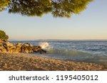 sea surf on a stony beach. in... | Shutterstock . vector #1195405012