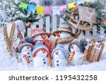 family of snowmen on skis and... | Shutterstock . vector #1195432258