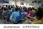 many people wait for hospital... | Shutterstock . vector #1195470412