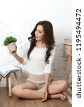 young beautiful asian woman sit ... | Shutterstock . vector #1195494472