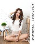 young beautiful asian woman sit ... | Shutterstock . vector #1195494475