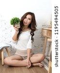 young beautiful asian woman sit ... | Shutterstock . vector #1195494505