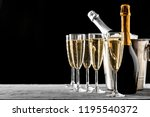 glasses of champagne with a... | Shutterstock . vector #1195540372