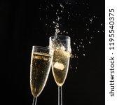 glasses of champagne with splash   Shutterstock . vector #1195540375