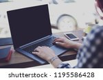 woman typing on notebook with... | Shutterstock . vector #1195586428