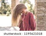 portrait of cute little girl.... | Shutterstock . vector #1195621018