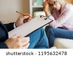 woman at therapy session | Shutterstock . vector #1195632478