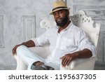 a black man in a white suit is... | Shutterstock . vector #1195637305