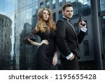 an elegant man with pistols in... | Shutterstock . vector #1195655428