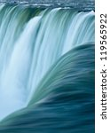 Close up of water rushing over Horseshoe Falls, Niagara Falls, Ontario, Canada - stock photo