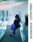 alone on escalator. bangkok ... | Shutterstock . vector #1195679005