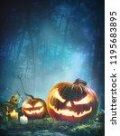 jack o  lanterns glowing at... | Shutterstock . vector #1195683895