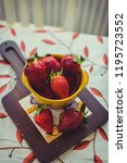 strawberries on a vintage... | Shutterstock . vector #1195723552