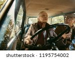 old woman driving a car and... | Shutterstock . vector #1195754002