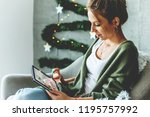 buying christmas gifts  ... | Shutterstock . vector #1195757992