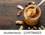 Peanut Paste In An Open Jar An...