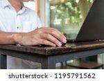 asian tan skin holding wireless ...   Shutterstock . vector #1195791562