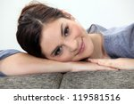 woman lying on couch | Shutterstock . vector #119581516
