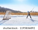 young hockey boy trains alone... | Shutterstock . vector #1195836892