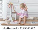 little girl play in the beauty... | Shutterstock . vector #1195840522