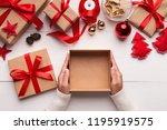 best christmas gift. woman... | Shutterstock . vector #1195919575
