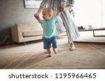 cute baby boy learning walking... | Shutterstock . vector #1195966465