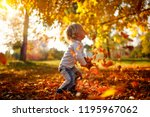 happy adorable child boy with... | Shutterstock . vector #1195967062