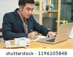 engineer using calculator and... | Shutterstock . vector #1196105848
