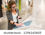 woman with phone uses self... | Shutterstock . vector #1196165605