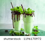 mint chocolate milkshake with... | Shutterstock . vector #1196170972